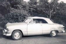 """Jean Boles' new Ford convertible with Pomeranian """"Tara"""" at the wheel, early 1950s"""
