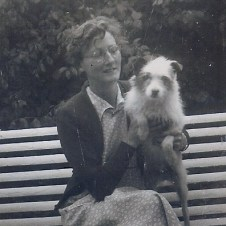 My grandfather's cousin Violet Boles with a furry friend, 1957.