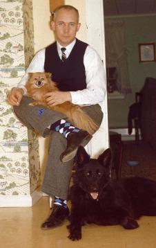 Tara the Pomeranian and Patty the Belgian Shepherd with Charles Brodhead, circa 1959