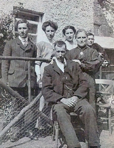 "In front of the Drumkeerin house ""Clooneen"": Edward Boles seated with wife Sarah holding his left shoulder. In rear: John, Jenny, Mary ""May"", and Ben. Possibly taken in 1912."