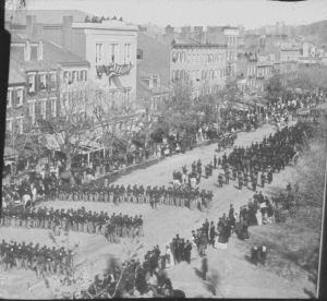 Lincoln's funeral procession on Pennsylvania Avenue on April 19, 1865. Lincoln was being moved from the White House to the Capitol rotunda. Photo is attributed in some places to Alexander Gardner.  Wikipedia: his image (or other media file) is in the public domain because its copyright has expired.