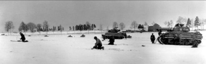 """""""Infantry & Tanks near Bastogne"""". Licensed under Public domain via Wikimedia Commons - http://commons.wikimedia.org/wiki/File:Infantry_%26_Tanks_near_Bastogne.jpg#mediaviewer/File:Infantry_%26_Tanks_near_Bastogne.jpg"""