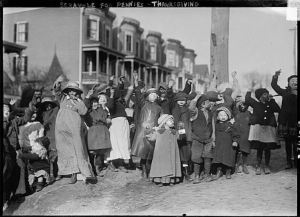 Thanksgiving Maskers scrambling for pennies (Courtesy of Library of Congress)