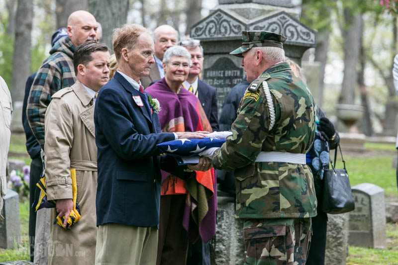 Thomas Woodruff receiving flag - IMAGE COPYRIGHT: CHUCK MARSHALL - USED WITH PERMISSION